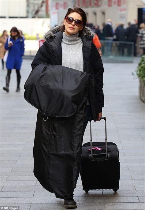 pregnant emma willis bundles up in black puffer coat after