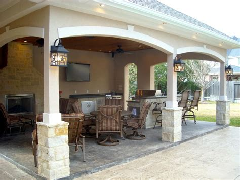 pool house with outdoor kitchen fireplace in cypress