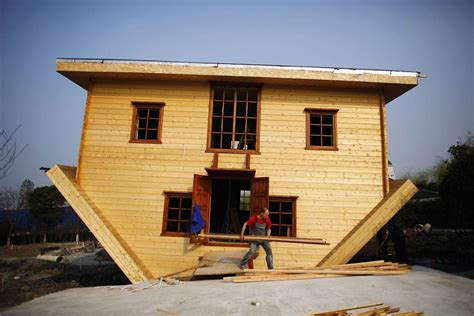 Workers Construct Upside-down House