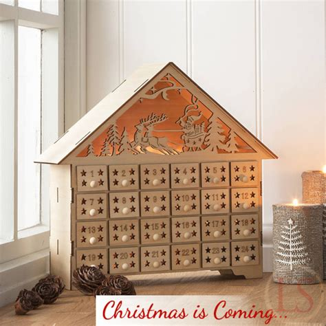pre christmas shopping gisela graham wooden advent house
