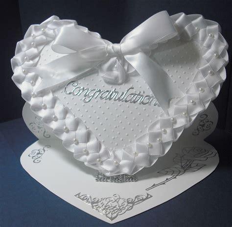 Ranging from rounded corners to classic tickets, bite marks to bubbles, we have something to boost your brand. Heart shaped easel card with white satin weaved ribbon and pearls | Cards handmade, Easel cards ...