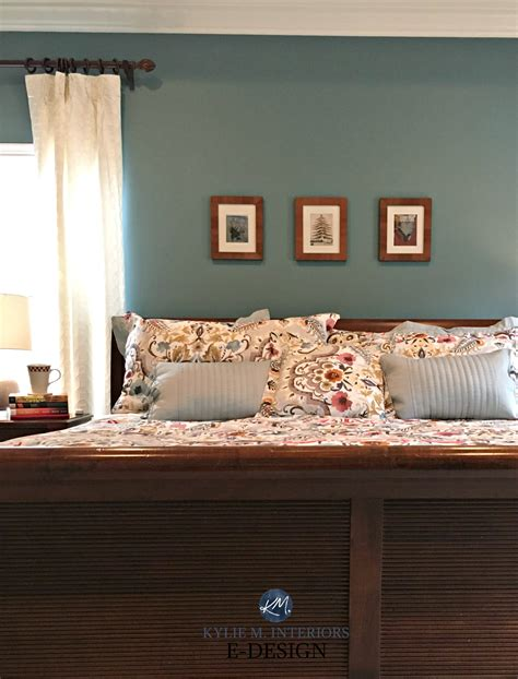 sherwin williams moody blue with cherry wood bedroom