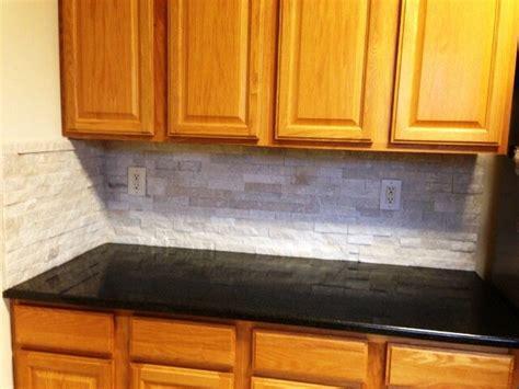 black pearl granite  medium wood cabinets traditional