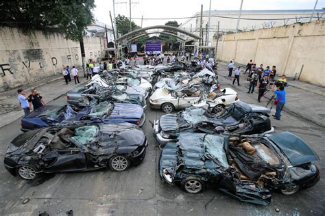 Duterte Leads Destruction Of Smuggled Luxury Cars Abs