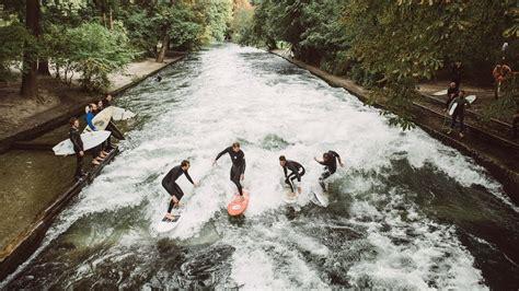 englischer garten münchen eis mick fanning surfs the eisbach river wave in munich