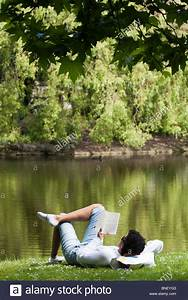 Spanish woman reading book beside pond in St Stephen's ...