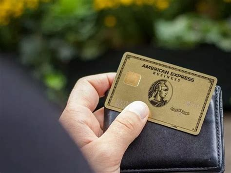Woman smiling and looking at her amazon credit card. best credit cards - Anygator.com