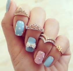 Adorable pink blue nail art with tiara rings pictures