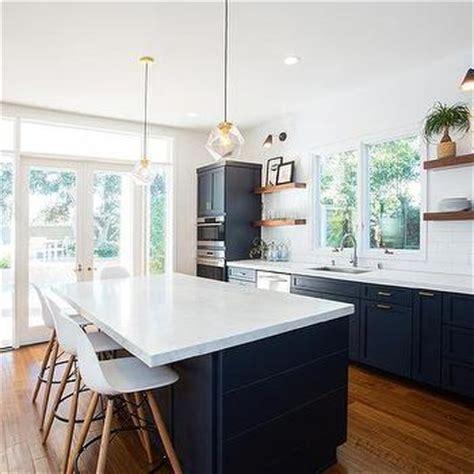 navy blue kitchen  floating shelves transitional