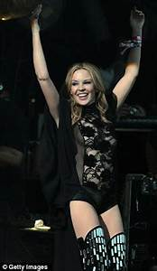 Kylie Minogue beams as she takes to the stage for her ...