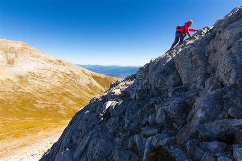 Woman Climbing Steep Mountain Slope Stock Photo Image