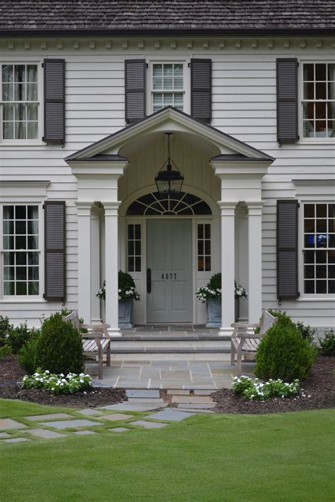 pictures of gray houses with colored doors grey