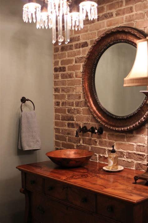 chic bathrooms  brick walls