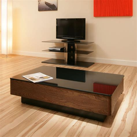 They are more popular type since ages because these are enduring. Modern Elm Wooden Coffee Table / Tables Black Glass Top Beautiful 868A