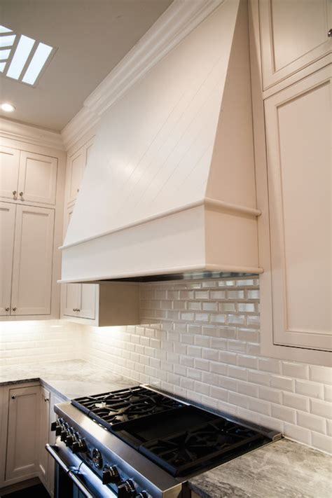 gray kitchen hood  gray spice cabinets transitional