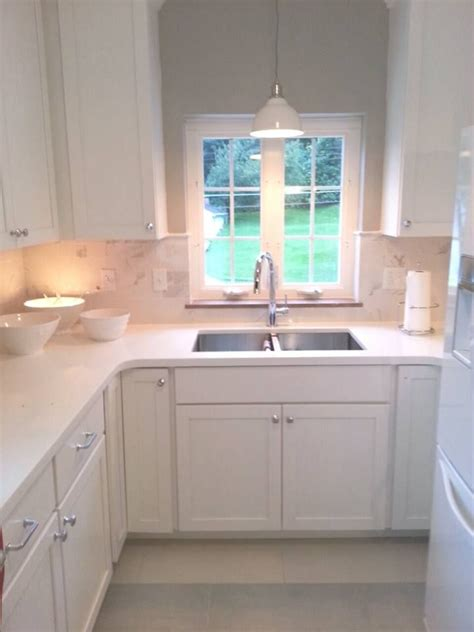 the idea of a light hanging the kitchen sink