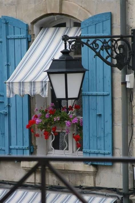 blue shutters  blue  white striped awning