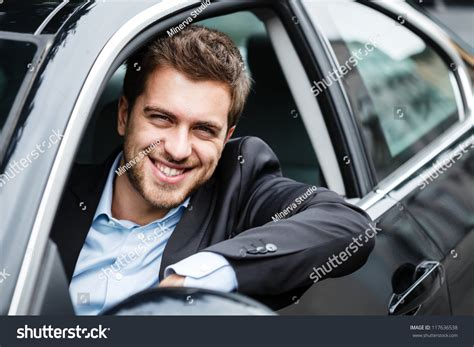 Portrait Of An Handsome Guy Driving His Car Stock Photo