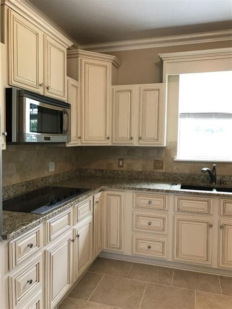 creamy  white painted kitchen cabinets  brown glaze