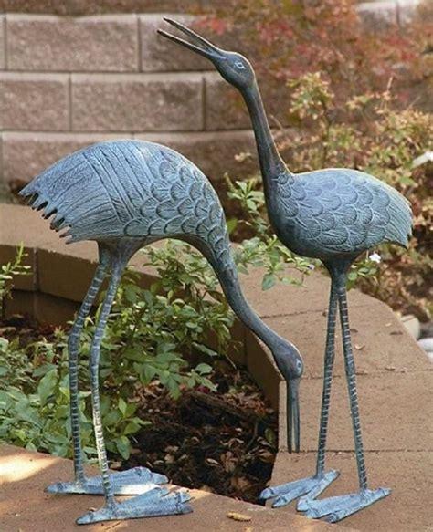 brass courting crane garden pair sculptures stately
