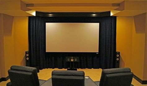 floating cinema screen a wall of velour curtains a