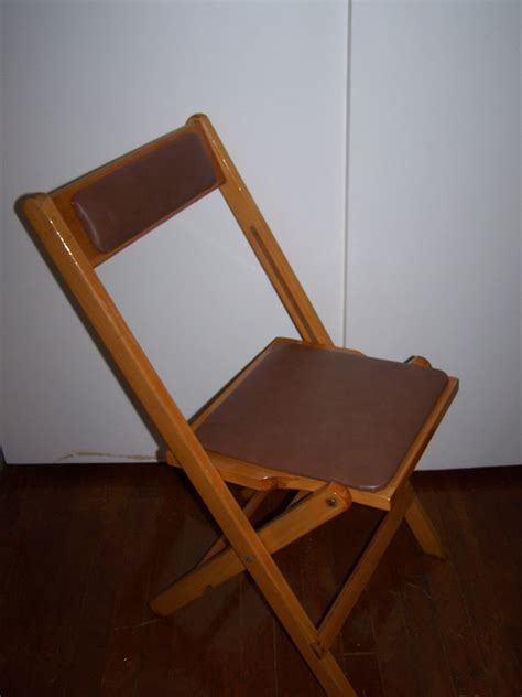 brown padded folding wood chair rental