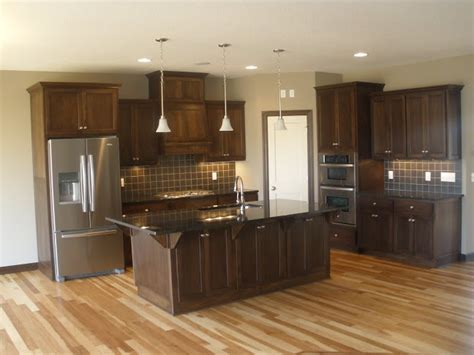 LDK Kitchen featuring Walnut cabinets, Hickory wood floors