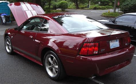 crimson red  ford mustang gt  anniversary edition