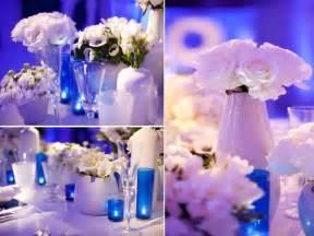 contemporary wedding modern wedding reception decor blue lighting white flowers and lounge furniture onewed