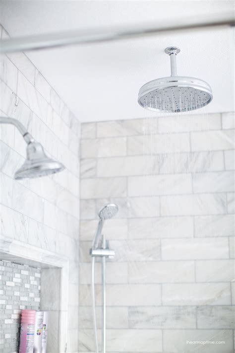 white shower tile bathroom makeover via i heart naptime grey and white bathroom remodel with carrara marble