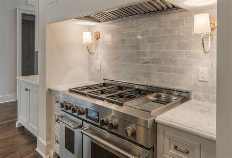 Cooker Backsplash : Reed Single Sconces On Gray Marble Backsplash Over Stove
