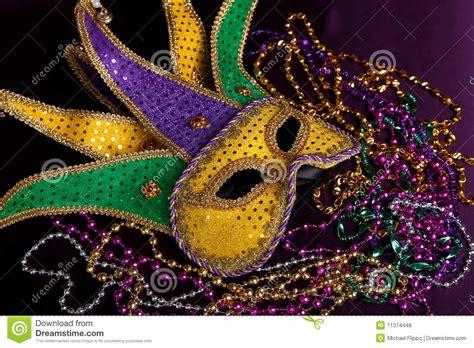 mardi gras mask  beads   purple background stock