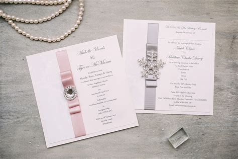 Wedding day invitations with a silver and blush pink