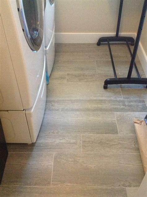 tile that looks like hardwood Bathroom Transitional with