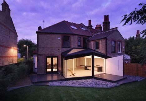 black white brick victorian home modern deck design