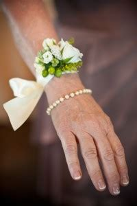 White Flower Wrist Corsage with double satin ribbon tie in