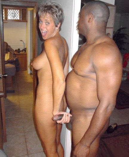 Smiling Mature Woman Grabs Black Dick With Her Hand Interracial Pictures