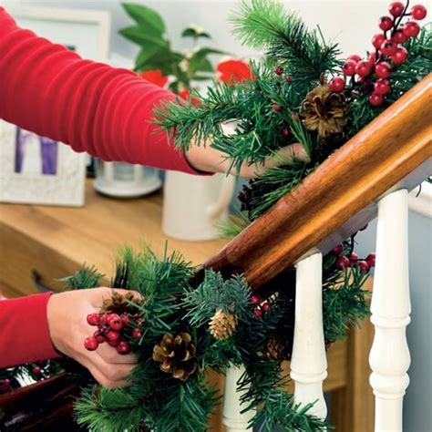 How To Decorate Banister With Garland by Wind A Garland Around Banisters Decorating