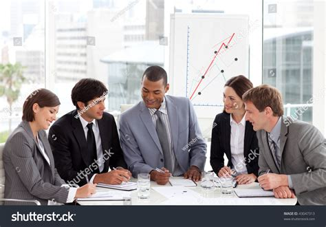 diverse business meeting diverse business sitting around a conference table