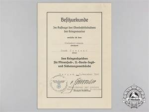 a group of award documents to stabsbootsman erich coriand With my qlink documents