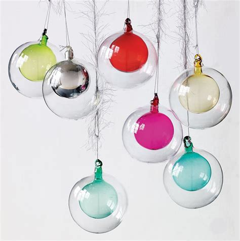 these rainbow colored ornaments layered inside clear glass