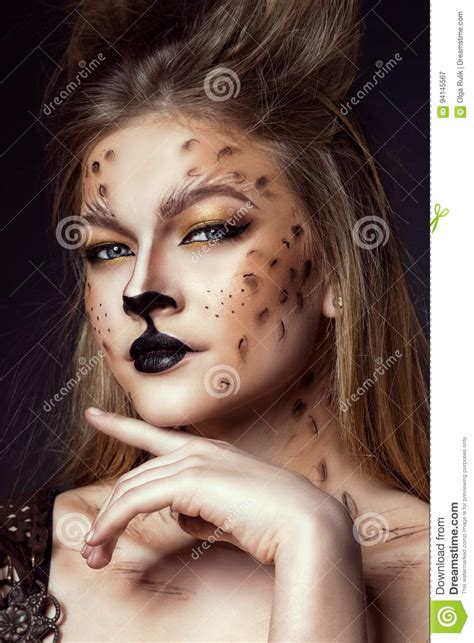 leopard make up up portrait of beautiful grey eyed model with