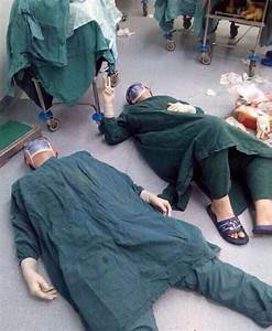 Two Surgeons Collapse On The Floor After 32-Hour Surgery