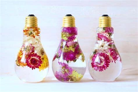 flower light bulb vase suspends beautiful blooms like