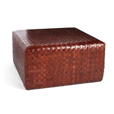 This cast away coffee table was the ultimate clean slate. Woven Leather Ottoman | Leather ottoman, Leather coffee table, Living room coffee table