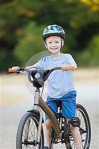 Kid Riding Bicycle Stock Photo - Image: 42491997
