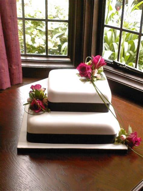 tier square wedding cake  fresh flowers susies cakes