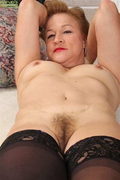 Smiling Mom Fingers Hot Hairy Pussy On The Floor Being Alone