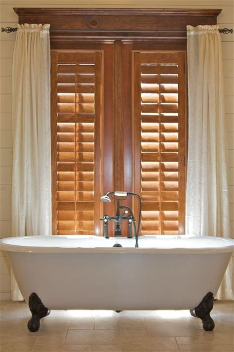 stained plantation shutters   claw foot tub