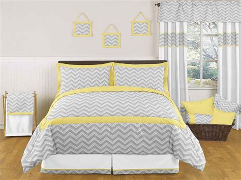 bedroom yellow and gray bedding with curtains